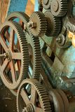 Greasy Gears and cogs spinning. Rusty and greasy gears on a old lath machine. spinning at slow speed Stock Photo