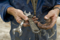 Greasy hands with tools. Hand shots of man preparing to drive piles stock photography