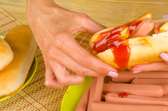 Greasy hot dog Stock Photography