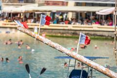 Greasy pole, three maltese flags royalty free stock images