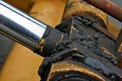 greasy skarvar för consructionutrustning Fotografering för Bildbyråer