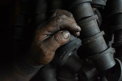 Greasy worker hand covered with oil. IN Lima factory in Peru South America royalty free stock photos