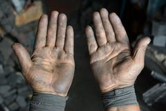 Greasy worker hand covered with oil. IN Lima factory in Peru South America stock photos