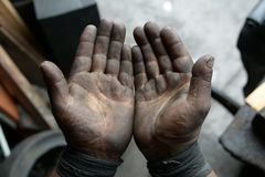 Greasy worker hand covered with oil. IN Lima factory in Peru South America stock images
