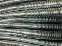 Amazing abstract closeup view of cable or other purpose metal pipes, fragment, industry Royalty Free Stock Images