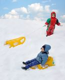 Great activity on snow, children Royalty Free Stock Image