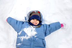 Great activity on snow, children Stock Photography