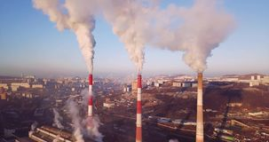 Aerial view of Central Heating and Power Plant chimneys with steam. Sunrise stock video