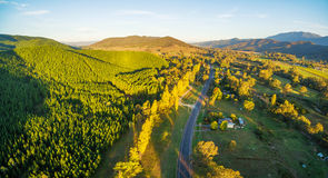 Great Alpine Road passing through Australian countryside at suns. Et - aerial landscape. Victoria, Australia Royalty Free Stock Image