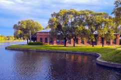 Great ancient brick building on the lake shore. Landscape: a large old brick building on the beach Stock Photography