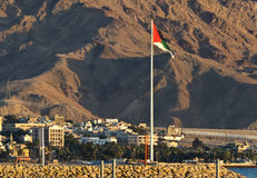 The Great Arab Revolt Flag, Aqaba, Jordan. The Great Arab Revolt Flag was erected to commemorate the Arab Revolt of 1916 against Ottoman Empire. The flag is the Stock Photography