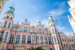 Great Armory in Gdansk, Poland. Great Armory or Academy of Fine Arts. Amazing facade and towers with spires in old historical town centre, Gdansk, Poland royalty free stock images