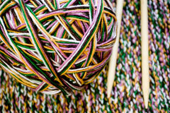 Great ball of colored yarn, wooden knitting needles and fabric Stock Images