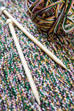 Great ball of colored yarn, wooden knitting needles and fabric Stock Photography