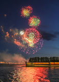 Great balls of fireworks in the sky. Fireworks over the Neva River in St. Petersburg Royalty Free Stock Photography