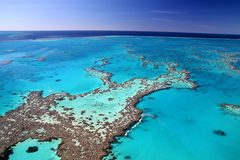 Great Barrier Reef colours. Aerial view of the magnificent Great Barrier Reef with its crystal clear waters and tropical islands. A romantic world heritage site stock photo