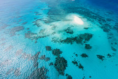 Great Barrier Reef and coral sand cay from above. Aerial capture of coral sand cay and Great Barrier Reef with clear blue water, Queensland, Australia stock photography