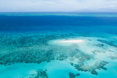 Great Barrier Reef and coral sand cay from above Royalty Free Stock Photography