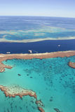 Great Barrier Reef, Queensland, Australia. Eco-tourism pontoons at the Great Barrier Reef, Queensland, Australia. Approximately two million tourists visit the Royalty Free Stock Photography