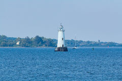 Great Beds Lighthouse in South Amboy New Jersey. A view of the Great Beds Lighthouse taken from South Amboy, New Jersey. Staten Island is seen in the background Stock Photo