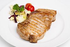 A great beef steak with vegetables Royalty Free Stock Images
