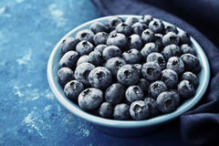 Great bilberry or blueberry in bowl on rustic background. Vintage style. Royalty Free Stock Photos