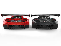 Great black and red supercars side by side Stock Photos