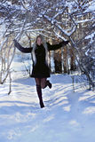 Great blonde in a winter forest Royalty Free Stock Image