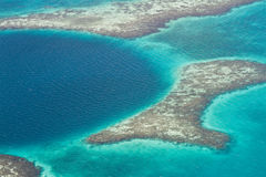 The great blue hole. Aerial view of the great blue hole of the coast of Belize Royalty Free Stock Photo
