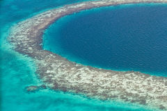 The great blue hole. Aerial view of the great blue hole of the coast of Belize Royalty Free Stock Photos