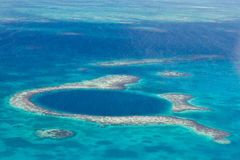 The great blue hole. Aerial view of the great blue hole of the coast of Belize Stock Image