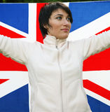 Great Britain. Young woman holding flag of Great Britain Royalty Free Stock Images