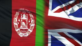 Great Britain and Afghanistan politicians exchanging top secret envelopes, flags. Stock footage vector illustration