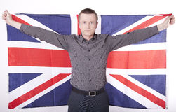Great Britain fan. Man holding flag of Great Britain with both hands Royalty Free Stock Photos