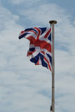 Great Britain flag against blue and cloudy sky Stock Image