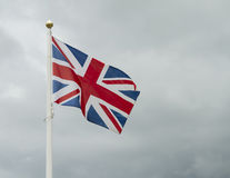 Great britain flag. Against stormy sky Stock Photography