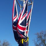 British flag. London. Great Britain flag and blue sky Royalty Free Stock Photo