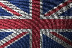 Great britain flag is depicted on the screen with the program code. The concept of modern technology and site development vector illustration