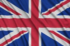 Great britain flag is depicted on a sports cloth fabric with many folds. Sport team banner. Great britain flag is depicted on a sports cloth fabric with many royalty free stock photos