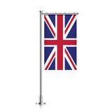 Great Britain flag hanging on a pole. Royalty Free Stock Photography
