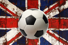 Great britain flag painted on wood with ball. Great britain flag  on old wood background with ball Stock Photography