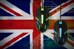 Great britain flag and two mice with backlight. Online cooperative games. Cyber sport team stock illustration