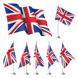 Great Britain flags. Great Britain  flags. A set of flags with metal stand, and one wavy flag fluttering on the wind. Created using gradient meshes Royalty Free Stock Photos