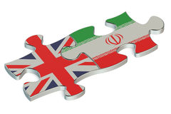 Great Britain and Iran puzzles from flags. 3D Royalty Free Stock Photos
