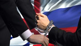 Great Britain sanctions Russia, chained arms, political or economic conflict. Stock footage stock video footage
