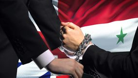 Great Britain sanctions Syria, chained arms, political or economic conflict. Stock footage stock video