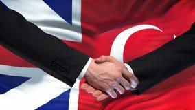Great Britain and Turkey handshake, international friendship, flag background. Stock footage stock video footage