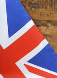 Great Britain UK Union Jack Flag. Against dark distressed recycled wood background stock image