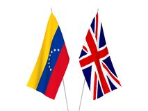 Great Britain and Venezuela flags. National fabric flags of Great Britain and Venezuela isolated on white background. 3d rendering illustration royalty free illustration