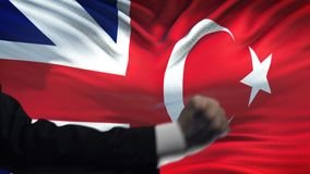 Great Britain vs Turkey confrontation, fists on flag background, diplomacy. Stock footage stock video footage